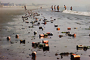 Boston, Massachusetts. Cans litter Revere Beach, after high school graduation night. Pollution, recycling.