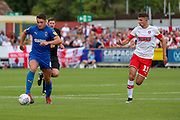 AFC Wimbledon midfielder Anthony Hartigan (8) dribbling away from Rotherham United midfielder Dan (Daniel) Barlaser (11) during the EFL Sky Bet League 1 match between AFC Wimbledon and Rotherham United at the Cherry Red Records Stadium, Kingston, England on 3 August 2019.