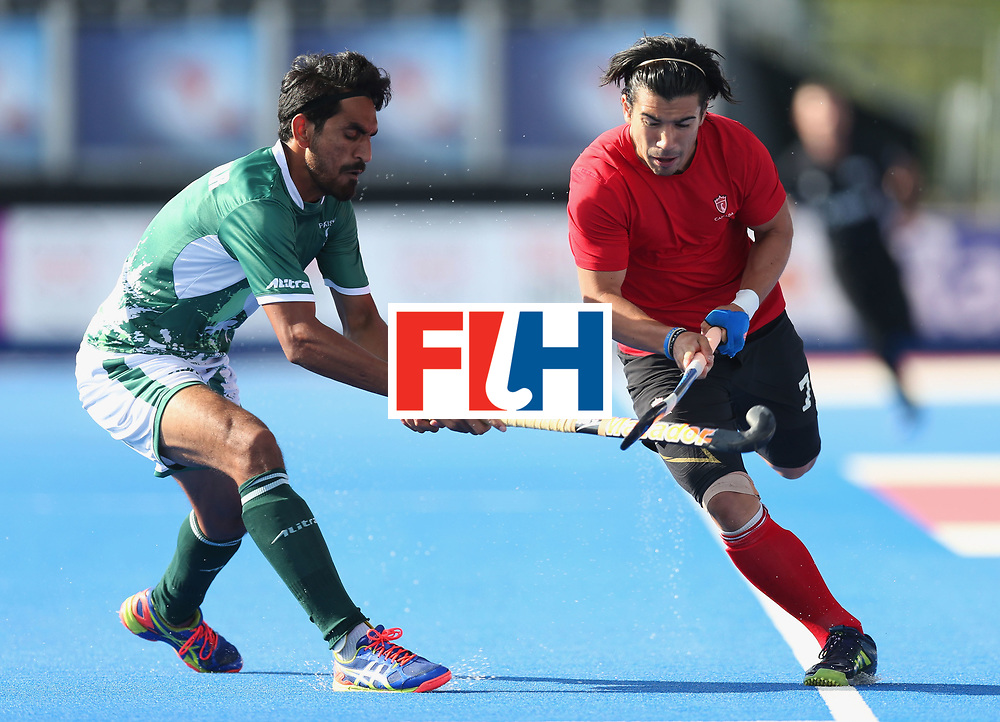 LONDON, ENGLAND - JUNE 16:  Gabriel Ho-Garcia of Canada takes on Tasawar Abbas of Pakistan during the Hero Hockey World League Semi-Final Pool B match between Pakistan and Canada at Lee Valley Hockey and Tennis Centre on June 16, 2017 in London, England.  (Photo by Alex Morton/Getty Images)