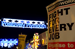 © under license to London News Pictures.  16/12/2010 Banners can be seen in front of Plymouth Christmas lights today (16/12/2010) in a demonstration against public sector cuts. Picture credit should read: David Hedges/LNP