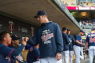 Joe Mauer #7 of the Minnesota Twins gets his teammates ready before a game against the Boston Red Sox on May 17, 2013 at Target Field in Minneapolis, Minnesota.  The Red Sox defeated the Twins 3 to 2.  Photo: Ben Krause
