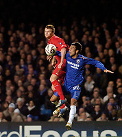 Photo: Leigh Quinnell.<br /> Chelsea v Liverpool. UEFA Champions League. <br /> 06/12/2005. Chelseas Paulo Ferreira rises in the air with Liverpools  John Arne Riise.