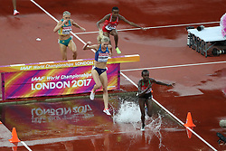 London, August 09 2017 . Celliphine Chepteek Chespol, Kenya, leads Emma Coburn, USA, Winfred Mutile Yavi, Bahrain, and Genevieve LaCaze, Australia, in the third heat of the women's 3,000m steeplechase heats on day six of the IAAF London 2017 world Championships at the London Stadium. © Paul Davey.
