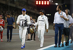 November 25, 2017 - Abu Dhabi, United Arab Emirates - Motorsports: FIA Formula One World Championship 2017, Grand Prix of Abu Dhabi, ..#77 Valtteri Bottas (FIN, Mercedes AMG Petronas F1 Team), #44 Lewis Hamilton (GBR, Mercedes AMG Petronas F1 Team) (Credit Image: © Hoch Zwei via ZUMA Wire)