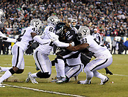 Dec 25, 2017; Philadelphia, PA, USA; Oakland Raiders linebacker Bruce Irvin (51) and cornerback Sean Smith (21) make a stop of Eagles running back Jay Ajayi (36) during a NFL football game at Lincoln Financial Field. The Eagles defeated the Raiders 19-10. Photo by Reuben Canales