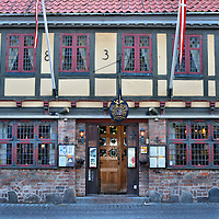 Den Gamle Kro Restaurant in Odense, Denmark <br /> This half-timbered building along Overgade street was built in 1683. Inside you will find a warm and charming setting reminiscent of an old Danish inn. The highly-rated Den Gamle Kro specializes in traditional Danish food plus some French entrées. Although it is a bit pricy, the ambiance, service and taste of Denmark make it an excellent choice for lunch or dinner.
