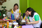 C&A Instituto volunteers making children's toys out of recycled materials.