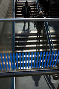 Pedestrians walk up and down the steps at Knightsbridge underground station next to the Harrods Department store, on 15th April 2019, in London, England.