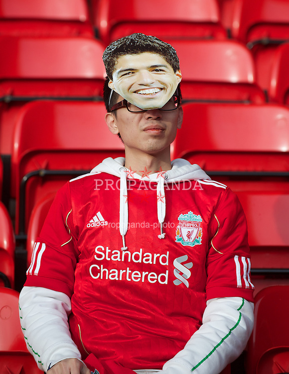 LIVERPOOL, ENGLAND - Saturday, January 28, 2012: A Liverpool supporter wearing a Luis Alberto Suarez Diaz face-mask before the FA Cup 4th Round match against Manchester City at Anfield. (Pic by David Rawcliffe/Propaganda)