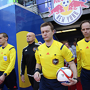 Referee Alan Kelly, (center) and assistant referee's Adam Wienckowski, (left) and Brian Poeschel lead the players out for the start of the New York Red Bulls Vs D.C. United Major League Soccer regular season match at Red Bull Arena, Harrison, New Jersey. USA. 22nd March 2015. Photo Tim Clayton