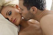 Man Kissing Woman's Face
