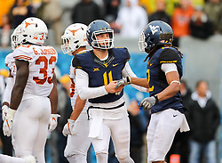 Nov 18, 2017; Morgantown, WV, USA; West Virginia Mountaineers quarterback Chris Chugunov (11) celebrates with West Virginia Mountaineers wide receiver Ka'Raun White (2) after a touchdown during the fourth quarter against the Texas Longhorns at Milan Puskar Stadium. Mandatory Credit: Ben Queen-USA TODAY Sports