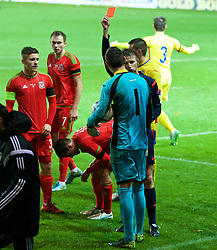 WREXHAM, WALES - Tuesday, November 17, 2015: Referee Mitja Zganec shows Romania's goalkeeper Laurentiu Branescu a red card and sends him off for assaulting Wales' Thomas O'Sullivan during the UEFA Under-21 Championship Qualifying Group 5 match at the Racecourse Ground. (Pic by David Rawcliffe/Propaganda)