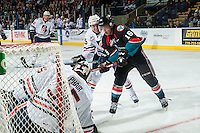 KELOWNA, CANADA - SEPTEMBER 24: Kole Lind #16 of the Kelowna Rockets takes a shot on Carter Phair #35 of the Kamloops Blazers on September 24, 2016 at Prospera Place in Kelowna, British Columbia, Canada.  (Photo by Marissa Baecker/Shoot the Breeze)  *** Local Caption *** Kole Lind; Carter Phair;