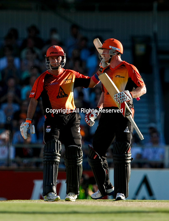 21.01.2012. Perth Australia. Big Bash Cricket.  Paul Collingwood congratulates Herschelle Gibbs on reaching fifty runs in the Semi Final between the Perth Scorchers and Melbourne Stars.