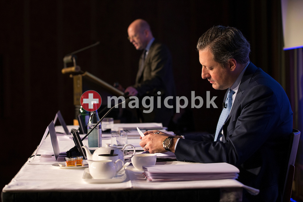 Boris F.J. Collardi, front, Chief Executive Officer (CEO), reads a paper while Dieter A. Enkelmann, Chief Financial Officer (CFO), speaks during a press conference on the fourth quarter and full-year results 2014 of Julius Baer Group Ltd. held at the Hotel Widder in Zuerich, Switzerland, on Monday, 2 February 2015. (Photo by Patrick B. Kraemer / MAGICPBK)