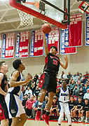 Watertown High School senior Wenston Rodriguez brings the ball to the basket during the MIAA Division 3 state semifinal game against Jeremiah E. Burke High School in Burlington, March 14, 2018. The Raiders won the game, 66-61. [Wicked Local Photo/James Jesson]