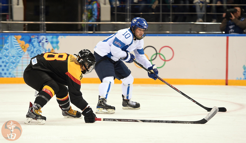 Feb 16, 2014; Sochi, RUSSIA; Finland forward Linda Valimaki (10) carries the puck past Germany forward Julia Zorn (8) in the women's ice hockey classifications round during the Sochi 2014 Olympic Winter Games at Shayba Arena.