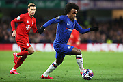 Chelsea forward Willian runs with the ball during the Champions League match between Chelsea and Bayern Munich at Stamford Bridge, London, England on 25 February 2020.