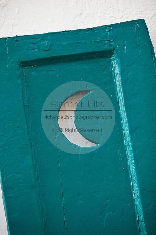 Antique shutter with half-moon Charleston, SC.