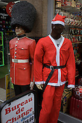 Grenadier guardsman mannequin and faceless Santa in London's Oxford Street.