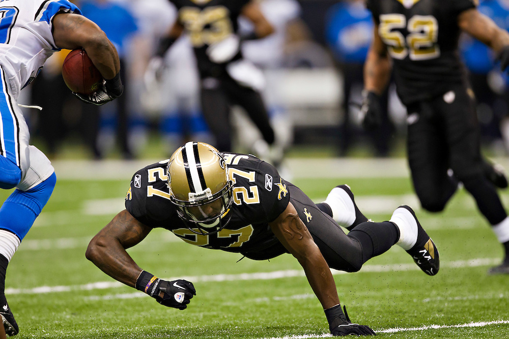 NEW ORLEANS, LA - DECEMBER 4:   Malcolm Jenkins #27 of the New Orleans Saints tries to tackle Kevin Smith #30 of the Detroit Lions with his shoulder at Mercedes-Benz Superdome on December 4, 2011 in New Orleans, Louisiana.  The Saints defeated the Lions 31-17.  (Photo by Wesley Hitt/Getty Images) *** Local Caption *** Malcolm Jenkins
