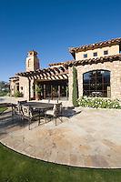 Paved dining area of Palm Springs hacienda