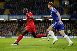 Mamadou Sakho of Liverpool is challenged by Branislav Ivanovic of Chelsea - Photo mandatory by-line: Rogan Thomson/JMP - 07966 386802 - 27/01/2015 - SPORT - FOOTBALL - London, England - Stamford Bridge - Chelsea v Liverpool - Capital One Cup Semi-Final Second Leg.