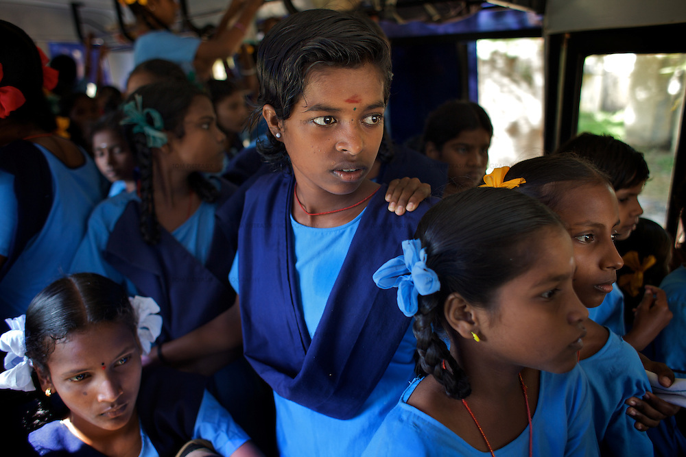 Residents of the Government Home for Tsunami Children and a neighbouring girls orphanage in Cuddalore travel on ths bus to the Government Girls High School, Venugopalapuram in Cuddalore. ..The Government Home for Tsunami Children in Cuddalore cares for children orphaned by the 2004 tsunami. Boys stay at the home until the age of 14 when they move to a boy's hostel. Girls are cared for as long as they remain in education and are under the age of 18. There are currently 52 children staying at the home which is housed in a purpose built complex of dormitories, a hall, primary school and vocational-learning centre. The orphanage provides time for reading and learning but without adequate support staff, most of the children do not apply themselves to study outside of school hours...Photo: Tom Pietrasik.Cuddalore, Tamil Nadu. India.October 5th 2009.
