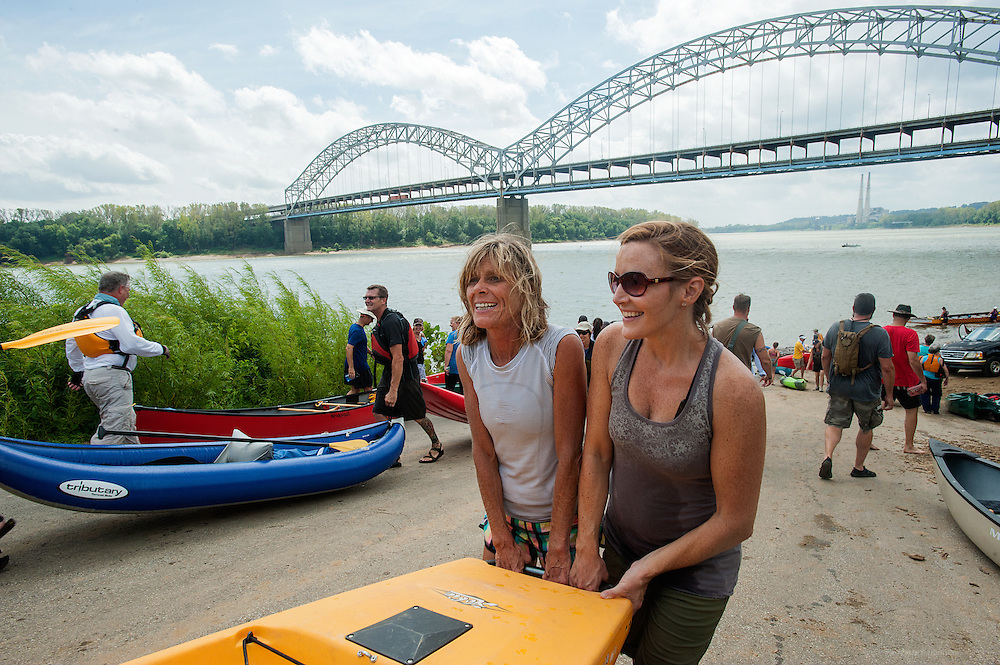 Ellen Jones, right, helps Cynthia Heady carry her husband's kayak up from the Jaycees Boat Ramp in New Albany at the end of the Mayor's Hike Bike & Paddle event at Waterfront Park. September 1, 2014