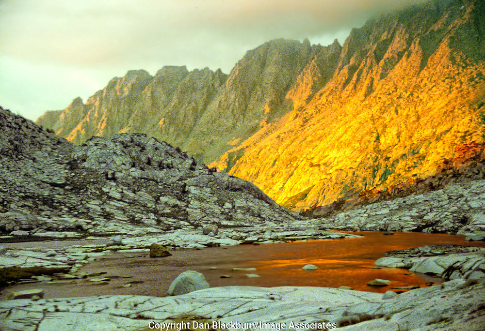 The setting sun puts its glow on the top of Le Conte Canyon near Dusy Basin in the Sierra high country of California.