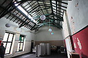 """You can buy this creepy old boarding school, complete with text books and furniture<br /> <br /> IF you want to live in a slightly creepy-looking old boarding school in Carmarthenshire, now's your chance.<br /> <br /> For Highmead School in Llanybydder is to go under the hammer at auction, with a list price of £750,000.<br /> <br /> The school closed in 1996 and has been left pretty much as it was, complete with text books and classroom furniture.<br /> <br /> It was built for Herbert Evans on the estate of his mother Elizabeth Lloyd, the last of the Llanfechan branch of the Lloyds of Castell Howell, and the entire site is 65,000 sq ft.<br /> <br /> It will go under the hammer on Tuesday, October 11, with national commercial property consultants, Lambert Smith Hampton (LSH) offering a freehold site which includes a partially modernised Grade II Listed mansion house with teaching and accommodation wings.<br /> <br /> There are 46 bedrooms, some of them en suite, along with several flats, two detached cottages, a swimming pool, gym, tennis courts plus a library, dining hall, reception hall and former admin offices as well as playing fields.<br /> <br /> """"This is a large and unique property with a great deal of potential, particularly for leisure or healthcare operators looking for a striking period building set in 27 acres of peaceful rural grounds with views across Welsh mountains,"""" said Simon Riggall, director and auctioneer at LSH Auctions.<br /> <br /> As well as the original mansion house, which boasts some exceptional original features such as a striking wooden staircase with marble pillars and fireplaces, there are extensive teaching and bedroom areas and this really is a rare opportunity to acquire something unusual given the setting, its history and the mix of properties available.""""<br /> <br /> If you would like to attend the auction, it will be held at Le Meridien Hotel in Piccadilly, London.<br /> <br /> Visit www.lshauctions.co.uk for more information.<br"""