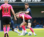 Peterborough United player Callum Elder shields the ball from Southend player Anthony Wordsworth during the Sky Bet League 1 match between Southend United and Peterborough United at Roots Hall, Southend, England on 5 September 2015. Photo by Bennett Dean.