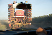 Driving behind farm vehicle on country road