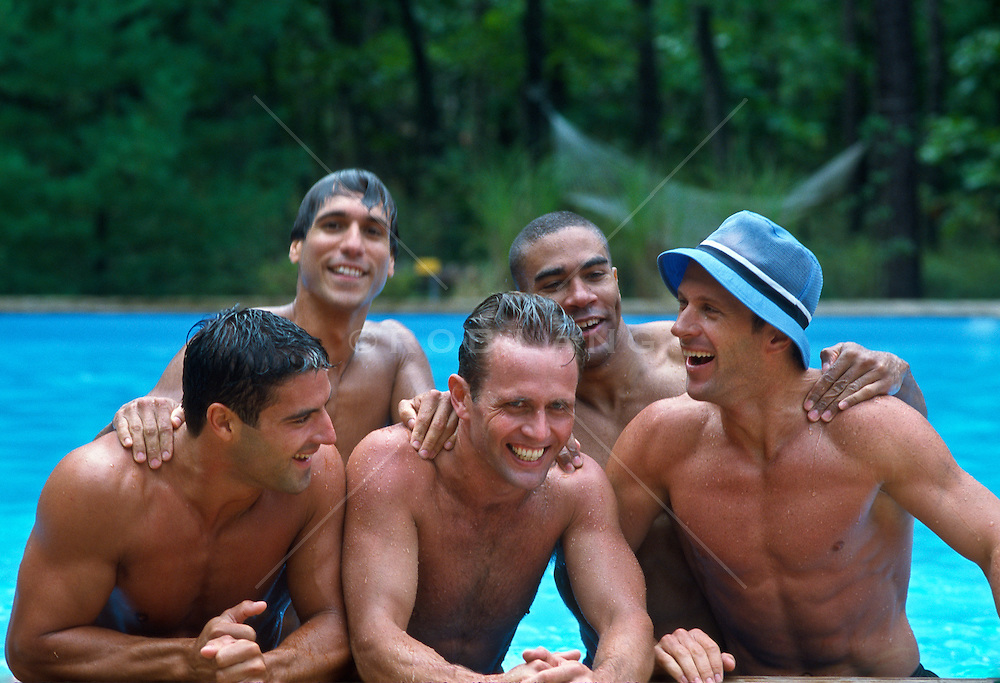 Five good looking men hanging out in a swimming pool