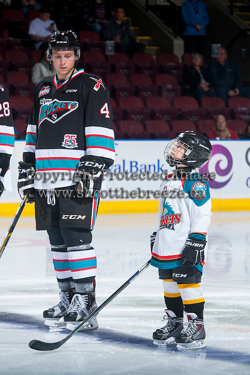 KELOWNA, CANADA - OCTOBER 24: Gordie Ballhorn #4 of Kelowna Rockets line up with the Pepsi Save On Foods Player of the game against the Calgary Hitmen on October 24, 2015 at Prospera Place in Kelowna, British Columbia, Canada.  (Photo by Marissa Baecker/Shoot the Breeze)  *** Local Caption *** Gordie Ballhorn; Pepsi Save On Foods Player;