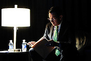 Gov. Dannel P. Malloy reads over his speech in a private area backstage while waiting as delegates nominate him as the Democratic candidate for governor at the Connecticut Democratic Convention in Hartford, Conn. (AP Photo/Jessica Hill)