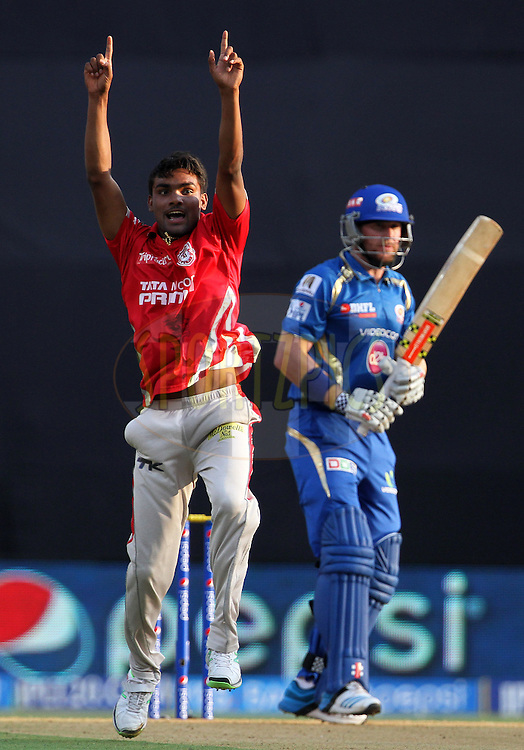 Sandeep Sharma of the Kings X1 Punjab celebrates after taking the wicket of Ben Dunk of the Mumbai Indians during match 22 of the Pepsi Indian Premier League Season 2014 between the Mumbai Indians and the Kings XI Punjab held at the Wankhede Cricket Stadium, Mumbai, India on the 3rd May  2014<br /> <br /> Photo by Vipin Pawar / IPL / SPORTZPICS<br /> <br /> <br /> <br /> Image use subject to terms and conditions which can be found here:  http://sportzpics.photoshelter.com/gallery/Pepsi-IPL-Image-terms-and-conditions/G00004VW1IVJ.gB0/C0000TScjhBM6ikg