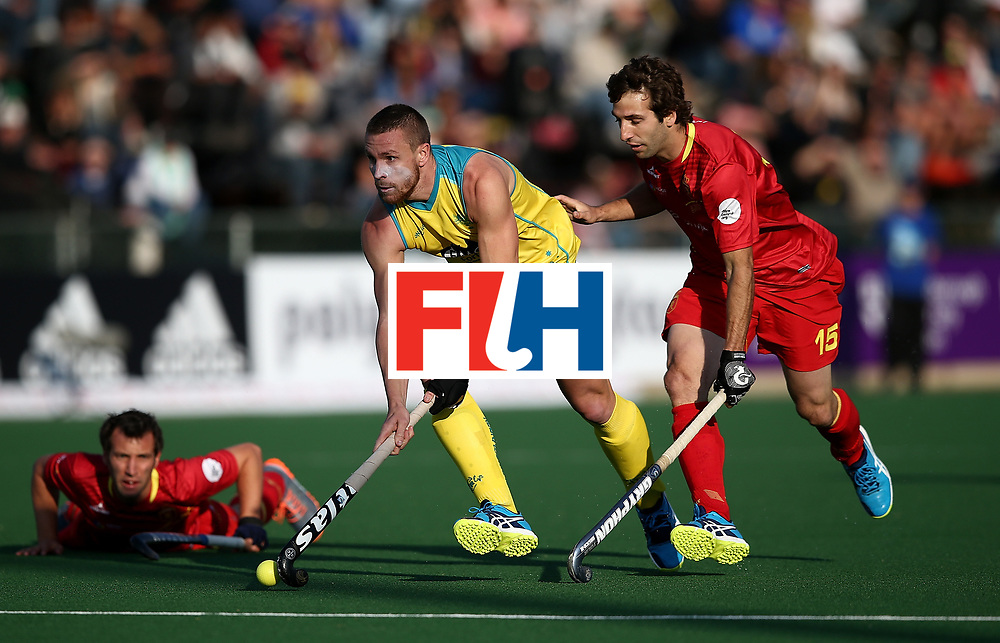JOHANNESBURG, SOUTH AFRICA - JULY 13:  Tom Wickham of Australia and Diego Arana of Spain battle for possession during day 3 of the FIH Hockey World League Semi Finals Pool A match between Spain and Australia  at Wits University on July 13, 2017 in Johannesburg, South Africa.  (Photo by Jan Kruger/Getty Images for FIH)
