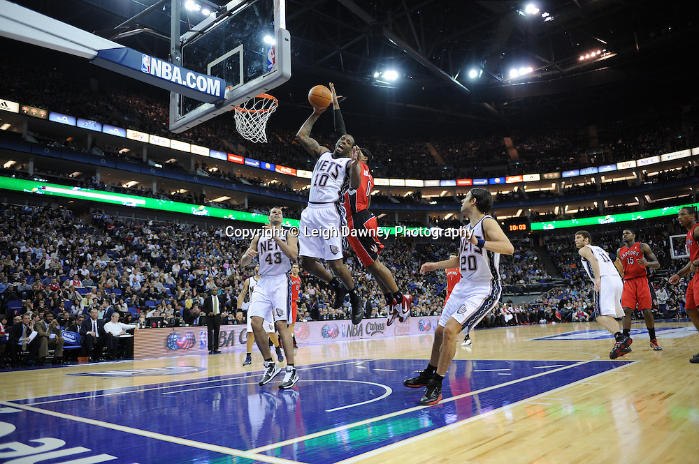 Damion James (New Jersey Nets) goes to dunk at the first NBA basketball regular season game in Europe at London's 02 Arena, 4th March 2011, sponsored by Thomson Sport. Photo credit © Leigh Dawney.
