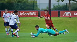 KIRKBY, ENGLAND - Saturday, August 10, 2019: Liverpool's Curtis Jones sees his shot saved by Tottenham Hotspur's goalkeeper Brandon Austin during the Under-23 FA Premier League 2 Division 1 match between Liverpool FC and Tottenham Hotspur FC at the Academy. (Pic by David Rawcliffe/Propaganda)