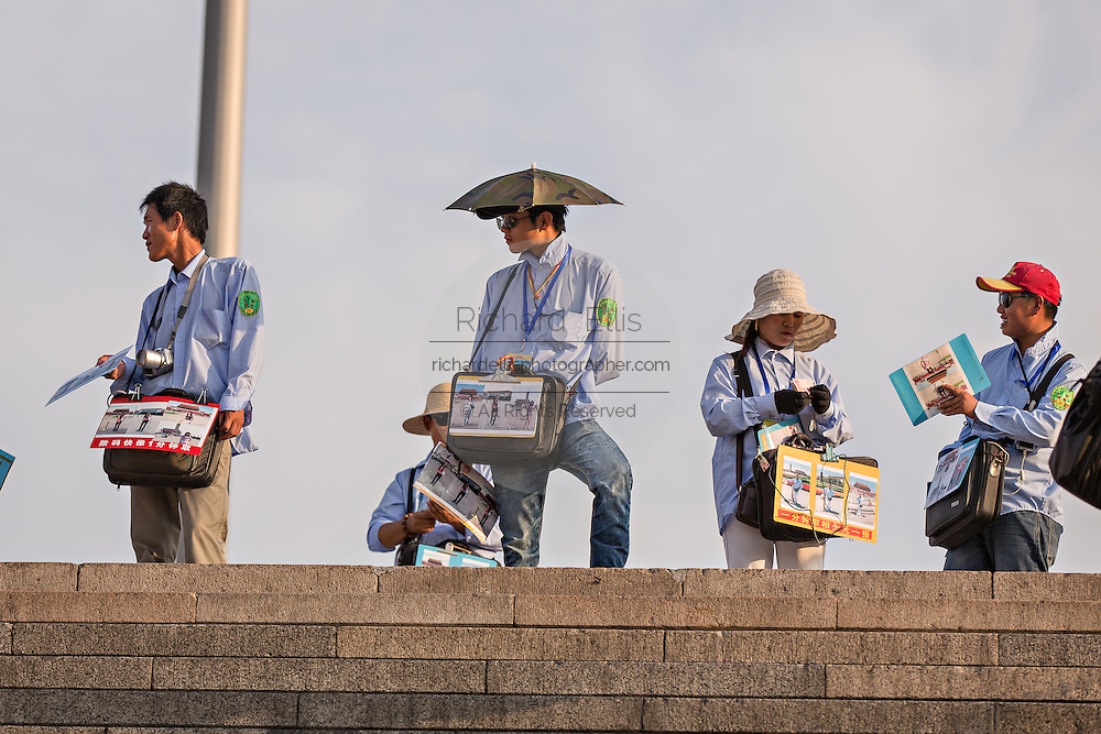 Vendors wait for tourist to come up the subway stairs at Tian'an Men Square in Beijing, China