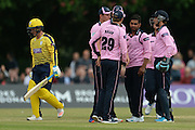 Middlesex bowler Ravi Patel and teammates celebrates the wicket of Hampshire all-rounder Will Smith  during the NatWest T20 Blast South Group match between Middlesex County Cricket Club and Hampshire County Cricket Club at Uxbridge Cricket Ground, Uxbridge, United Kingdom on 27 May 2016. Photo by David Vokes.