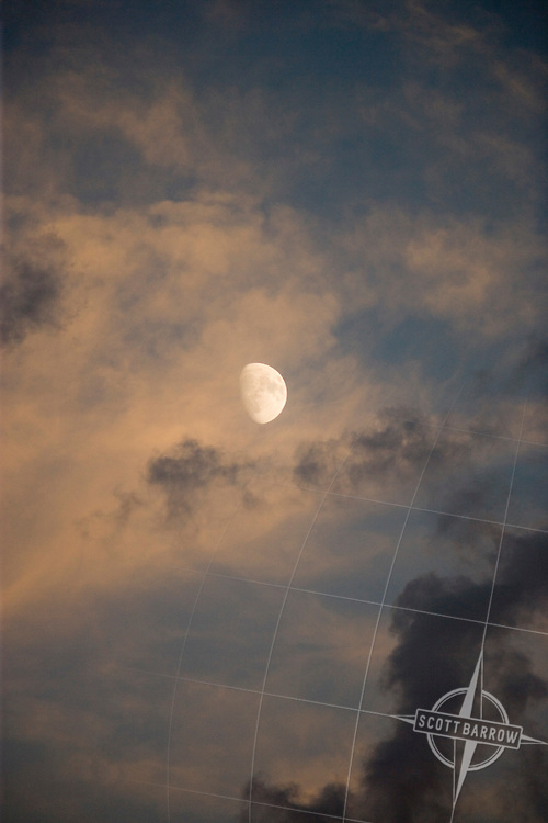 Waxing Gibbous moon with clouds.