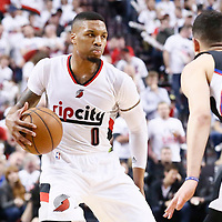 25 April 2016: Portland Trail Blazers guard Damian Lillard (0) dribbles during the Portland Trail Blazers 98-84 victory over the Los Angeles Clippers, during Game Four of the Western Conference Quarterfinals of the NBA Playoffs at the Moda Center, Portland, Oregon, USA.