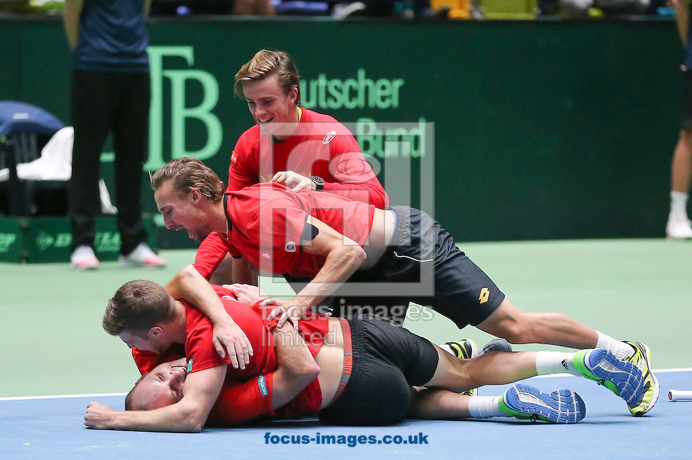 Steve Darcis of Belgium and team mates celebrate after beating Alexander Zverev of Germany to make their score three rubbers to one during the world group first round 2017 Davis Cup match between Germany and Belgium in the Fraport Arena, Frankfurt, Germany.<br /> Picture by EXPA Pictures/Focus Images Ltd 07814482222<br /> 05/02/2017<br /> *** UK &amp; IRELAND ONLY ***<br /> <br /> EXPA-EIB-170205-0223.jpg