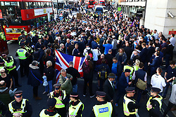 © Licensed to London News Pictures . 27/09/2018. London, UK. A crowd of supporters block Ludgate Hill as they surround former EDL leader Tommy Robinson (real name Stephen Yaxley-Lennon ) after his retrial for Contempt of Court was adjourned following his actions outside Leeds Crown Court in May 2018 . Robinson was already serving a suspended sentence for the same offence when convicted in May and served time in jail as a consequence , but the newer conviction was quashed by the Court of Appeal and a retrial ordered . Photo credit: Peter Macdiarmid/LNP