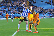 Gary Hooper of Sheffield Wednesday and Wolverhampton Wanderers defender Ethan Ebanks-Landell during the Sky Bet Championship match between Sheffield Wednesday and Wolverhampton Wanderers at Hillsborough, Sheffield, England on 20 December 2015. Photo by Ian Lyall.