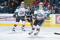KELOWNA, CANADA - FEBRUARY 18: Colton Heffley #25 and Damon Severson #7 of the Kelowna Rockets skate on the ice against the Red Deer Rebels at the Kelowna Rockets on February 18, 2012 at Prospera Place in Kelowna, British Columbia, Canada (Photo by Marissa Baecker/Shoot the Breeze) *** Local Caption ***