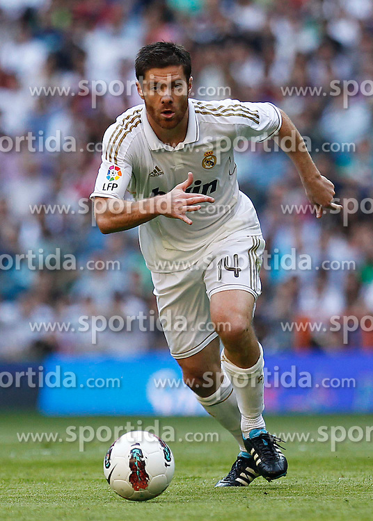 15.10.2011, Estadio Santiago Bernabeu, Madrid, ESP, Primera Division, Real Madrid vs Real Betis, im Bild Xabi Alonso...   // during Primera Division football match between Real Madrid and Real Betis at Santiago Bernabeu Stadium, Madrid, Spain on 15/10/2011. EXPA Pictures © 2011, PhotoCredit: EXPA/ Alterphoto/ Alex Cid-Fuentes  +++++ ATTENTION - OUT OF SPAIN/(ESP) +++++